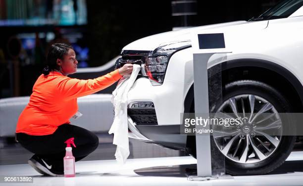 Worker cleans a GAC GS8 at the GAC Motors exhibit at the 2018 North American International Auto Show January 16, 2018 in Detroit, Michigan. More than...