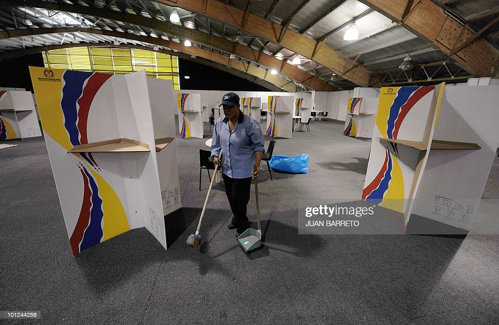 A worker cleans a polling center in Bogota, May 28, 2010. Colombia will hold presidential elections next May 30, and according to polls, a run-off election between Antanas Mockus for the Green Party and Juan Manuel Santos for the ruling National Unity Party, will take place on June 20.