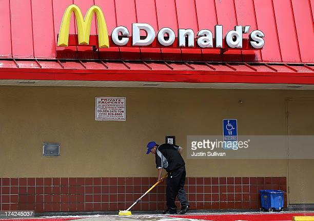A worker cleans a sidewalk outside of a McDonald's restaurant on July 22 2013 in San Francisco California McDonald's stock slipped in Monday trading...