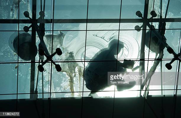 Worker cleans a skylight in the Capitol Visitor Center, Monday.