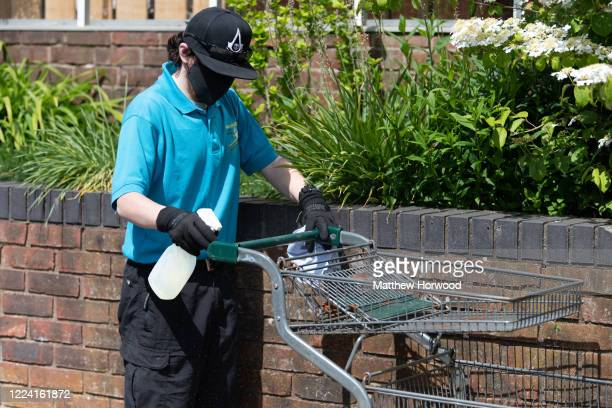 Worker cleans a trolley at Caerphilly Garden Centre on May 11, 2020 in Cardiff, United Kingdom. Wales' First Minister Mark Drakeford announced on...