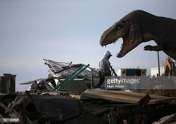 A worker cleans debris from the Fun Town Pier that was damaged by Superstorm Sandy February 19 2013 in Seaside Heights New Jersey Governor Chris...