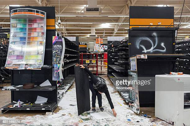 A worker cleans debris inside a Grupo Comercial Chedraui SA store after looting in Veracruz City Mexico on Saturday Jan 7 2017 Mexico's National...