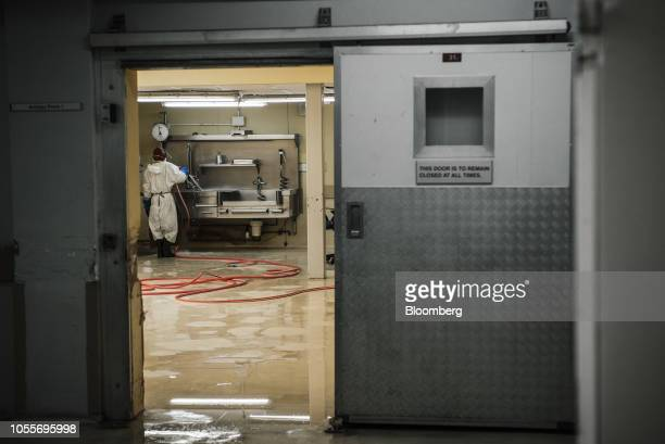 A worker cleans down surfaces and equipment in an autopsy room at the Johannesburg Forensic Pathology Services mortuary in Johannesburg South Africa...