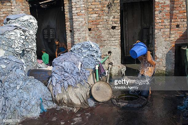 Worker cleans himself as other workers are seen on duty at Hazaribagh Tannery in Dhaka, Bangladesh on January 11, 2016. Industry Minister of Senegal...