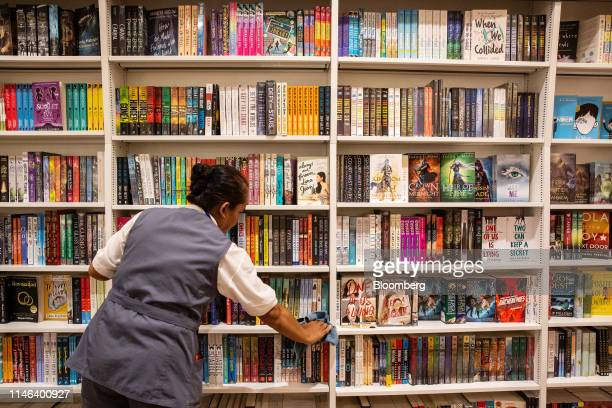A worker cleans in the Kinokuniya Co book store at the Aeon Mall in Phnom Penh Cambodia Sunday May 26 2019 Kinokuniya Japan's largest bookstore chain...