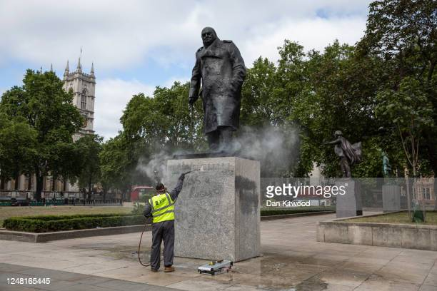 Worker cleans the Churchill statue in Parliament Square that had been spray painted with the words 'was a racist' on June 08, 2020 in London,...