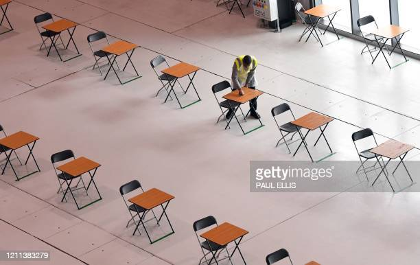 A worker cleans the desks in the canteen for staff working on the assembly line to produce ventilators at the Advanced Manufacturing Research Centre...