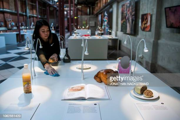 A worker cleans the exhibition at the Disgusting Food Museum in Malmo on November 7 2018 Cheese teeming with squirming maggots sheep's eye juice and...