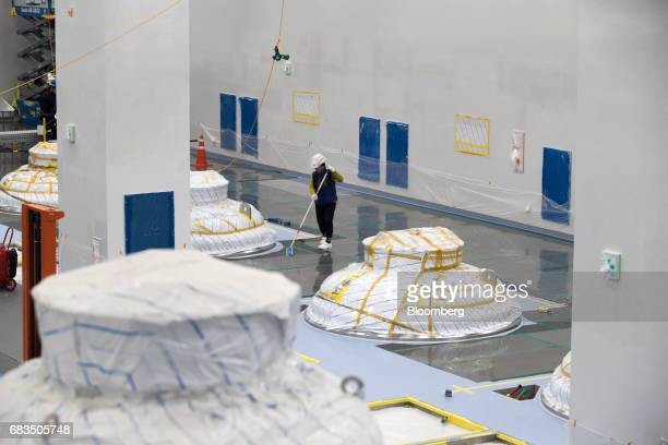 A worker cleans the floor of a bioreactor hall at the under construction Plant 3 inside the Samsung BioLogics Co headquarters and production...