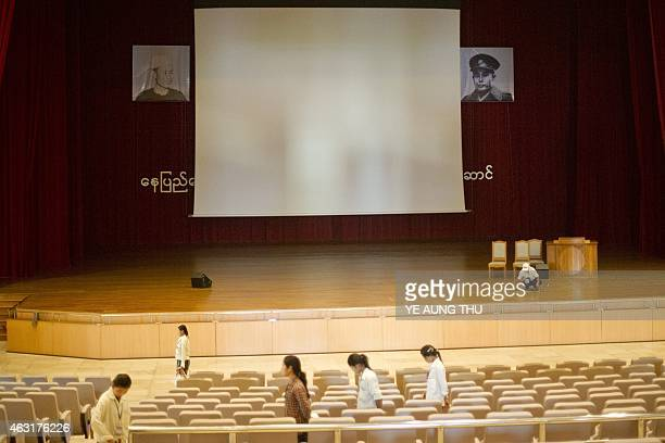A worker cleans the floor underneath a portrait of General Aung San inside the parliment in NayPyiDaw on February 11 2015 Celebrations will mark a...
