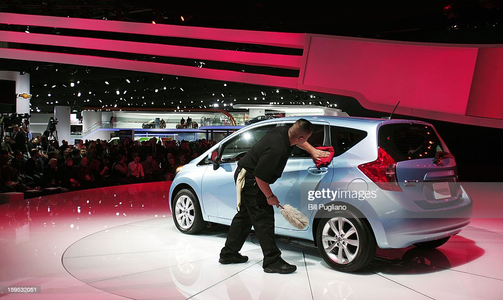 A worker cleans the new Nissan Versa Note just prior to its reveal at the 2013 North American International Auto Show media preview at the Cobo Center January 15, 2013 in Detroit, Michigan. Approximately 6,000 members of the media from 68 countries are attending the show this year. The 2013 NAIAS opens to the public January 19th.