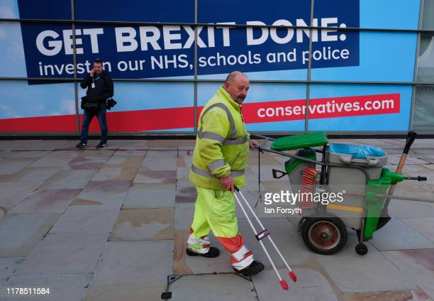 A worker cleans the pavements on the final day of the Conservative Party Conference at Manchester Central at Manchester Central on October 02 2019 in...