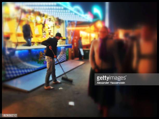 Worker cleans the Theresienwiese on October 1, 2013 in Munich, Germany. The Munich Oktoberfest, which this year will run from September 21 through...