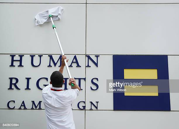 Worker cleans the wall of the Human Rights Campaign building, June 17, 2016 in Washington, DC. Images of the 49 people killed in the Orlando terror...