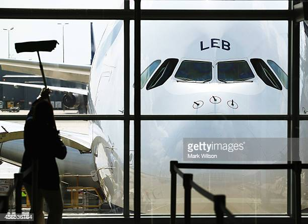 A worker cleans the windows in front of British Airways' new super jumbo Airbus A380 after it arrived at Washington Dulles International Airport...