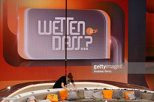 Worker cleans up the couch after the 'Wetten, dass..?' tv show on April 5, 2014 in Offenburg, Germany. The ZDF announced tonight the end of 'Wetten,...