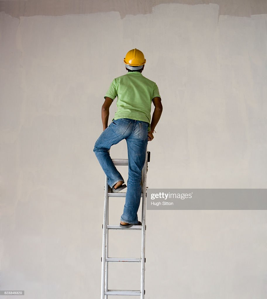 Worker Climbing Ladder Stock Photo | Getty Images for Worker Climbing Ladder  53kxo