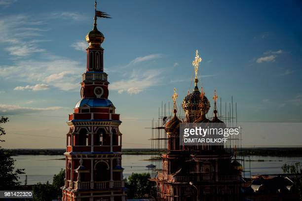 Worker climbs scaffoldings during the reconstruction of the Church of the Nativity on the bank of the Volga river in the city of Nizhniy Novgorod, on...