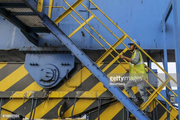 A worker climbs the stairs of a gantry crane at Krishnapatnam Port in Krishnapatnam Andhra Pradesh India on Saturday Aug 12 2017 Growth in gross...