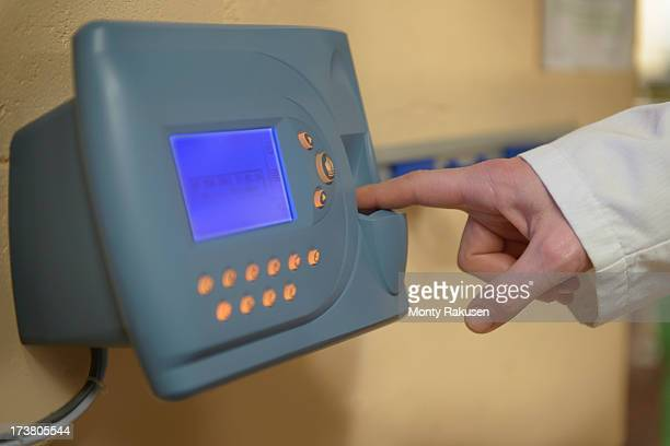 worker clocking in using fingerprint recognition technology in food factory - biometrics stock photos and pictures