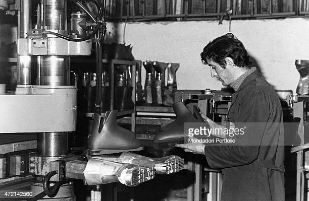 Worker committed in the manufacturing of Sanmarco ski boots Italy 1979