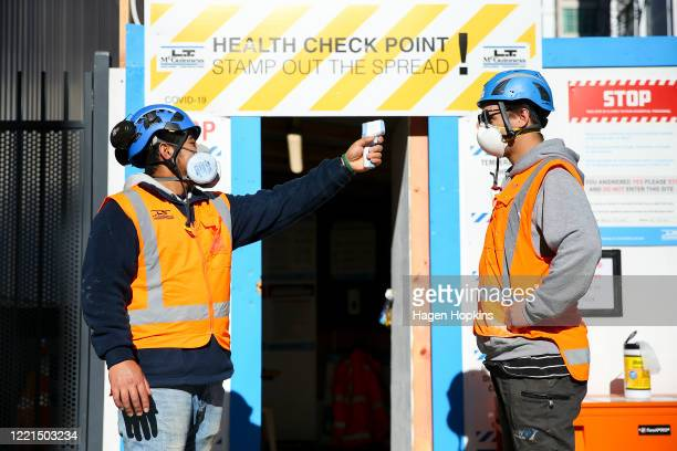 Worker conducts a temperature check at the entrance of a construction site on April 28, 2020 in Wellington, New Zealand. New Zealand's lockdown...