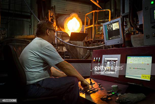 Worker controlling a blast furnace of the Ortrander Eisenhuette GmbH an ironworks on July 03 in Ortrand Germany The ironworks manufactures with...