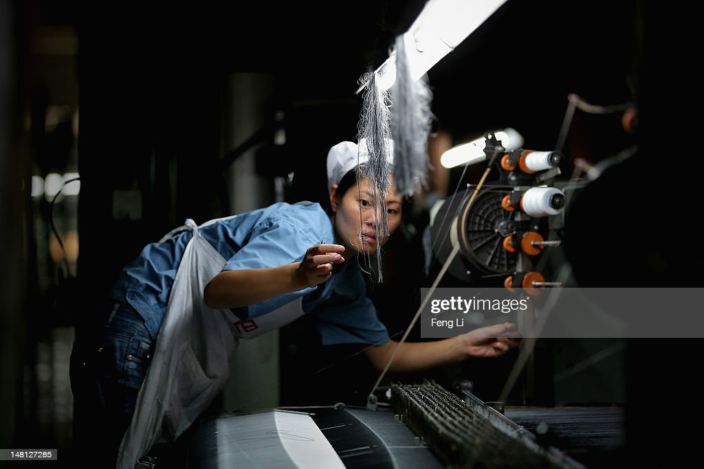 A worker controls the production line of textile at Babei Group Co., Ltd on July 3, 2012 in Shengzhou of Zhejiang Province, China. Chinese Premier Wen Jiabao said Tuesday that stabilizing economic growth is the most pressing matter currently facing China. China's central bank's sudden cut in the benchmark interest rates for the second time in a month confirmed the pessimistic view of the current economic situation.