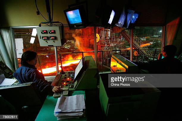A worker controls the production of steel plates at a Shanghai Baosteel Group factory January 15 2007 in Shanghai China According to state media...