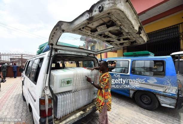 A worker counts ballot boxes loaded into a van at the Independent National Electoral Commission central office in Port Harcourt Rivers State on March...