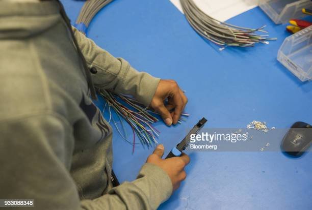 A worker cuts wires during production of a LulzBot 3D printer at the Aleph Objects Inc facility in Loveland Colorado US on Wednesday March 14 2018...