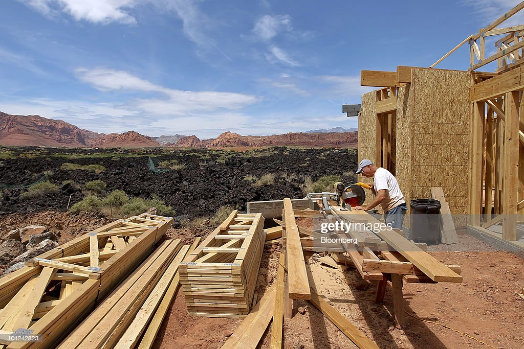 A worker cuts wood for a new home under construction at the Split Rock at Entrada development in St. George, Utah, U.S., on Wednesday, May 26, 2010. Housing starts rose to a 672,000 annual rate last month, the highest since October 2008 and up 5.8 percent from March, Commerce Department figures showed this month. After almost five years of falling sales and prices, homebuilders are looking to see if the nation's fledgling economic recovery can sustain the real estate market as government subsidies end. Photographer: George Frey/Bloomberg via Getty Images
