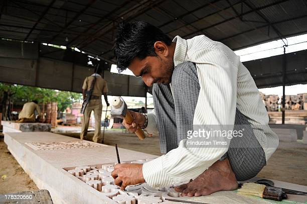 Worker cutting stone in workshop run by VHP for preparation to build Ram temple even though the case of the disputed land is in the Supreme Court on...