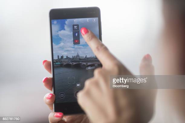 A worker demonstrates live filming capabilities of the Nokia 8 smartphone designed by HMD Global Oy ahead of its official unveiling in London UK on...