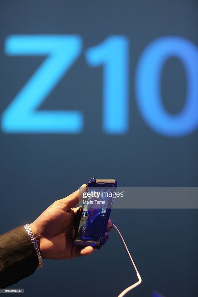 A worker demonstrates the Blackberry Z10 video feature at the BlackBerry 10 launch event at Pier 36 in Manhattan on January 30, 2013 in New York City. The new smartphone and mobile operating system is being launched simultaneously in six cities.