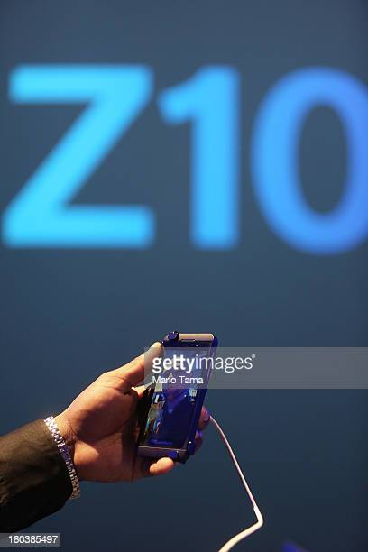 A worker demonstrates the Blackberry Z10 video feature at the BlackBerry 10 launch event at Pier 36 in Manhattan on January 30 2013 in New York City...