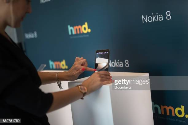 A worker demonstrates the Nokia 8 smartphone designed by HMD Global Oy ahead of its official unveiling in London UK on Tuesday Aug 15 2017 The phone...