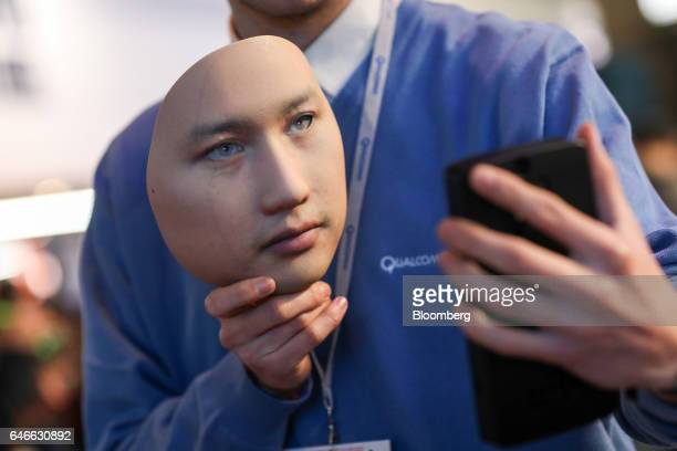 A worker demonstrates the Qualcomm Iris Authentication Solution on the Qualcomm Inc stand on the third day of Mobile World Congress in Barcelona...