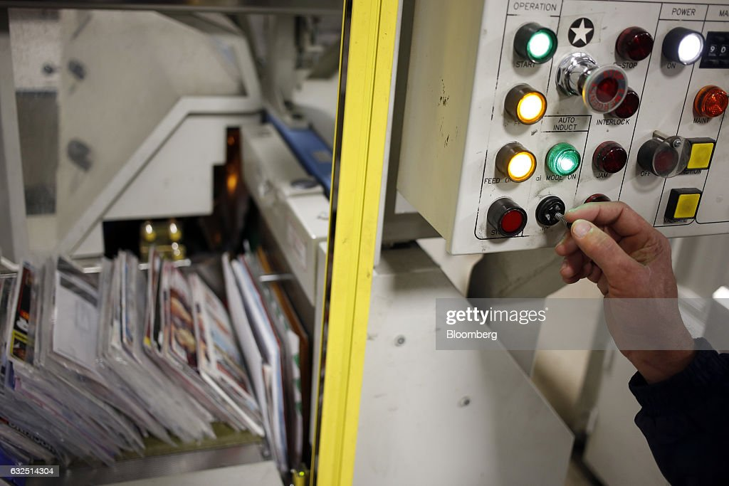 A worker demonstrates the use of an automated mail sorting machine at the United States Postal Service (USPS) sorting center in Louisville, Kentucky, U.S., on Friday, Jan. 13, 2017. Starting January 22, the cost of mailing a one-ounce first-class letter will return to being 49 cents, up from 47 cents, where it had been since April. Photographer: Luke Sharrett/Bloomberg via Getty Images