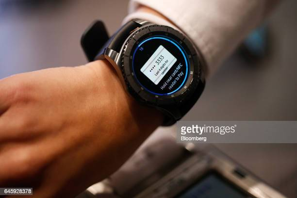 A worker demonstrates wireless payment using the Samsung Pay app on a Gear smartwatch manufactured by Samsung Electronics Co Ltd on the opening day...