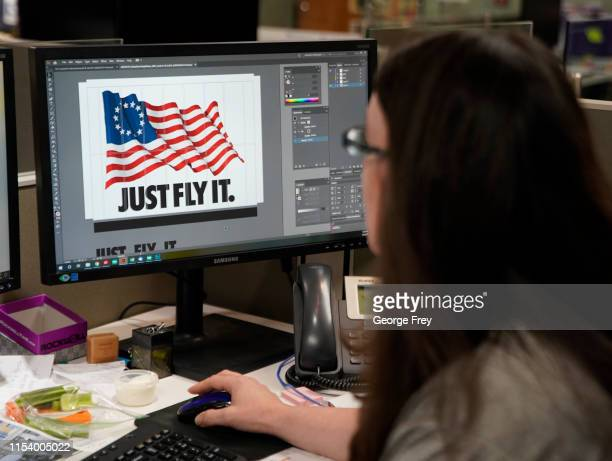 A worker designs a Just Fly It tshirt with the Betsy Ross flag at Colonial Flag on July 5 2019 in Salt Lake City Utah The Betsy Ross Flag became a...