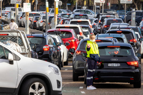 AUS: Sydney Introduces Greater Covid-19 Restrictions As Cases Surge