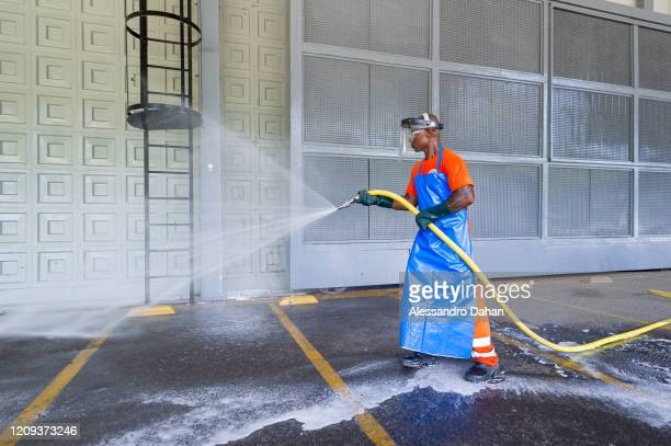 A worker disinfects a field hospital under construction in Riocentro Convention Center on April 07 2020 in Rio de Janeiro Brazil The facility is...