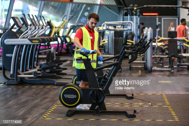 A worker disinfects an exercise bike in the gym at London Aquatics Centre on July 25 2020 in London England After further easing of the United...