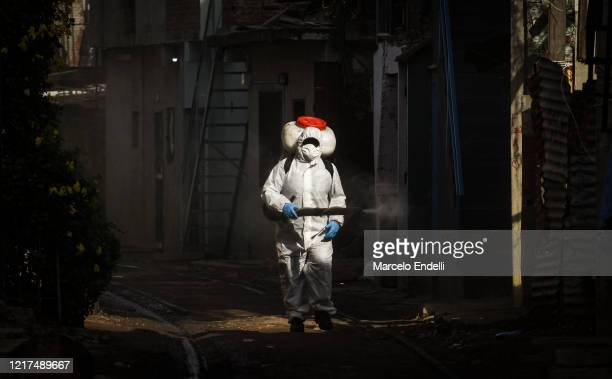 A worker disinfects the houses of the Villa 2124 on June 3 2020 in Buenos Aires Argentina Governmentordered lockdown was extended until June 07 due...