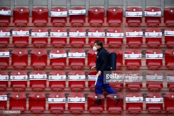 Worker disinfects the stands during the WTA Madrid Open tennis tournament at the Caja Magica in Madrid on May 3, 2021.