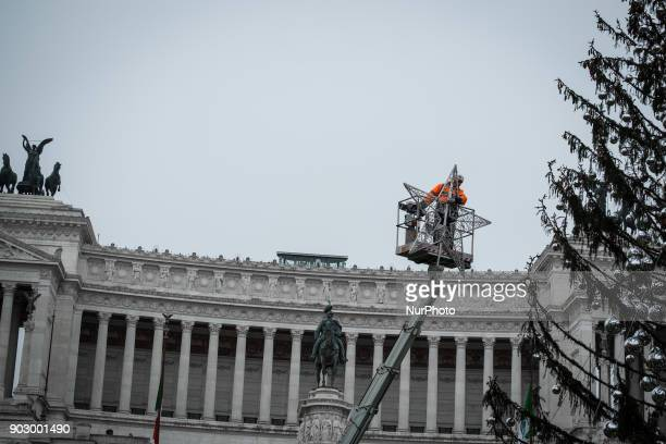 A worker dismantels Rome's official Christmas tree also called quotSpelacchioquot by Roman citiziens in Rome Italy 09 January 2018 Rome's official...