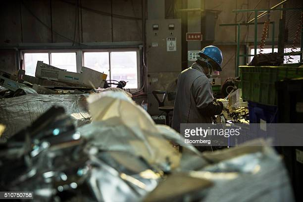 A worker dismantles a printer at the Super Dragon Technology Inc ewaste processing facility in Taoyuan Taiwan on Wednesday Jan 13 2016 Super Dragon...