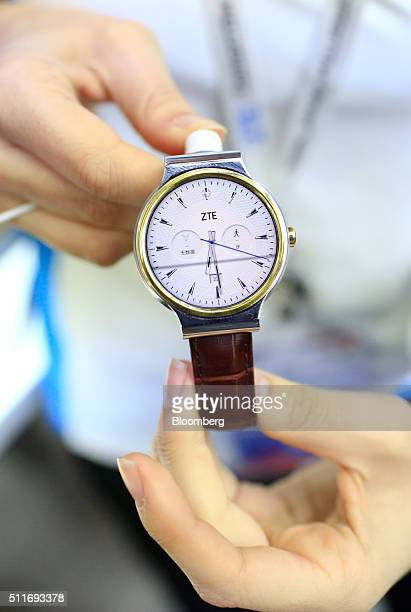 A worker displays the Axon Watch manufactured by ZTE Corp at the Mobile World Congress in Barcelona Spain on Monday Feb 22 2016 Mobile World Congress...